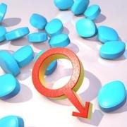 modré pilulky so znakom mužského pohlavia